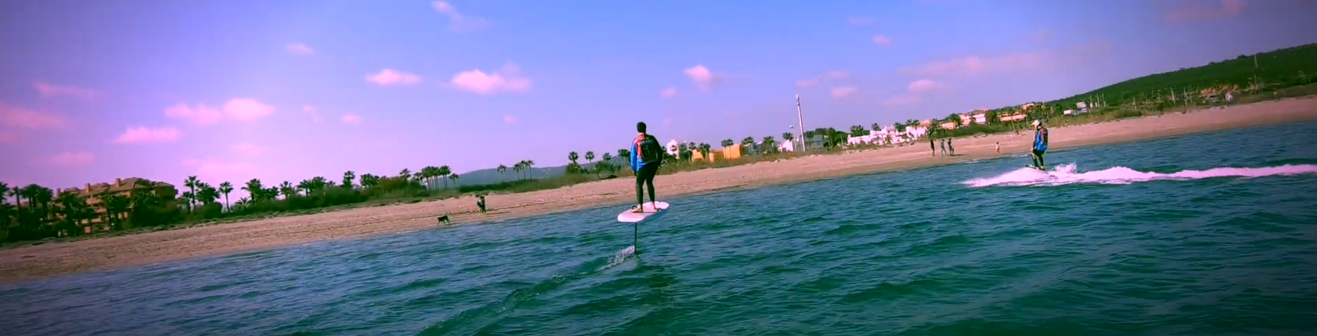 2 Guys on electric surfboard