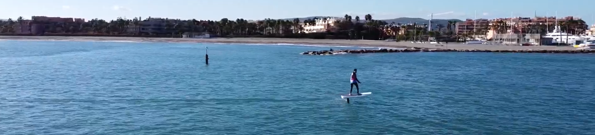 Man riding by shore